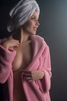 Nude girl in bathrobe after shower cropped shot