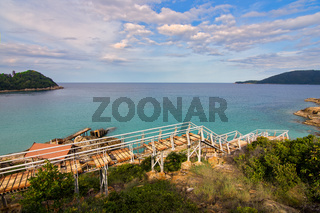 Concrete stairs and walk way leading down to the 'broken pier' in an paradise empty bay on Perhentian Kecil, Malaysia.