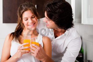 youn couple cheersing their drink