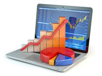 Stock market online business concept. Graph and diagram on laptop keyboard with stock market chart on the screen.