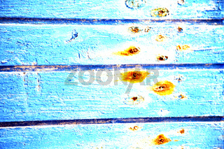 dirty stripped   in the blue  door and rusty