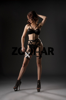 Model in lingerie and leather - bdsm and fetish