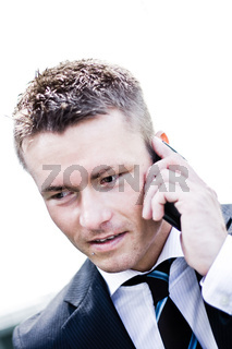 Closeup Photo Of A Handsome Corporate Man On The Phone