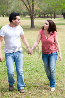 Couple walking holding hands and smiling
