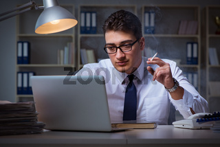 The businessman under stress smoking in office