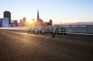 empty road with cityscape of modern city in blue sky