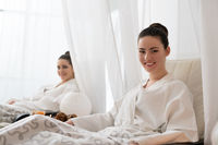 Young pretty brunettes with fine bunches in spa
