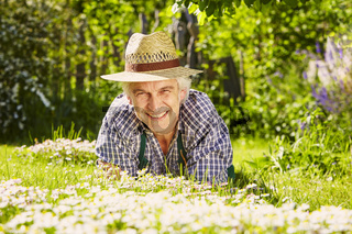 Man with hat in field of flowers