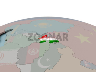 Political map of Tajikistan on globe with flag