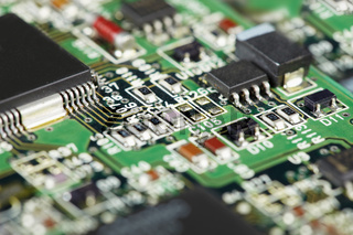 Surface of electronic circuit board - soldered components