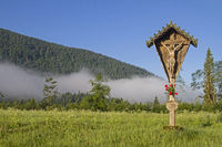 Idyllic wooden cross in the Jachenau