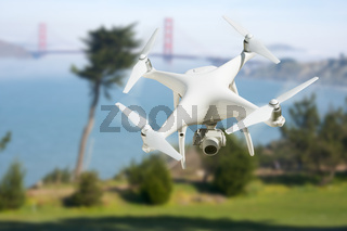 Unmanned Aircraft System (UAV) Quadcopter Drone In The Air Near The San Francisco Golden Gate Bridge.