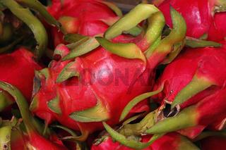 Red ripe pitaya or pitahaya dragon fruit close up