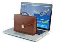 Stock market online business concept. Briefcase on laptop keyboard with stock market char on the screen.