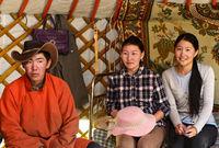 young man and two young women in a yurt, Erdenet region, Mongolia