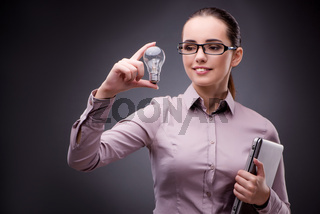 Young businesswoman in idea concept with light bulb