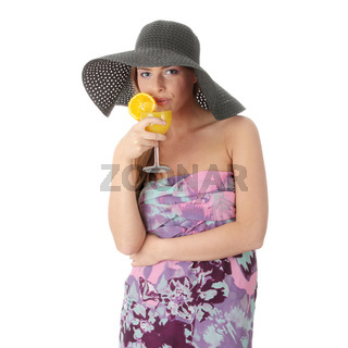 Beautiful woman holding a orange cocktail