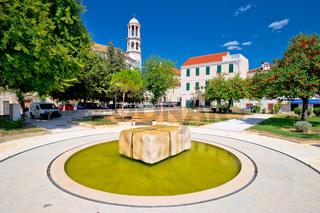 Kastel Novi fountain and church view