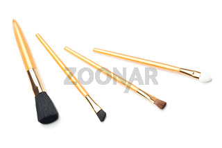Are four brushes makeup on a white background