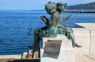 Le Sartine statue at  Trieste waterfront in Italy
