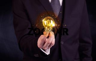 office worker holding a light bulb