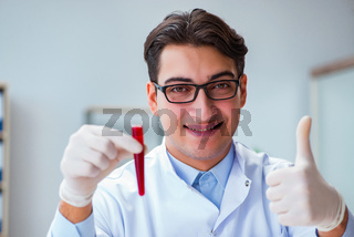 Doctor with red blood sample