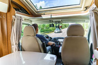 Man driving on a road in the Camper Van