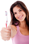 beautiful young woman holding toothbrush and smiling on isolated white background