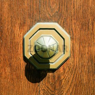 old brass door knob at outdoor wooden door