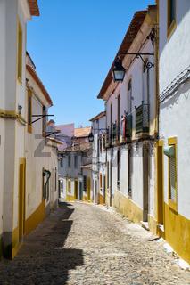 The view of cozy narrow street of Evora. Portugal