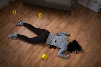dead woman body in blood on floor at crime scene