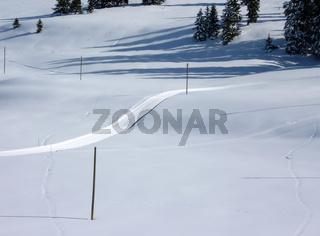 Ski slope in snowy mountain