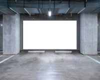 Parking garage underground with blank billboard