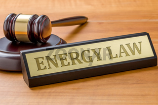 A gavel and a name plate with the engraving Energy law