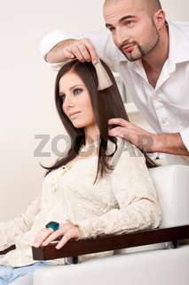 Professional hairdresser choose hair dye color at salon
