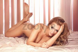 Sensual photo of beautiful naked blonde woman