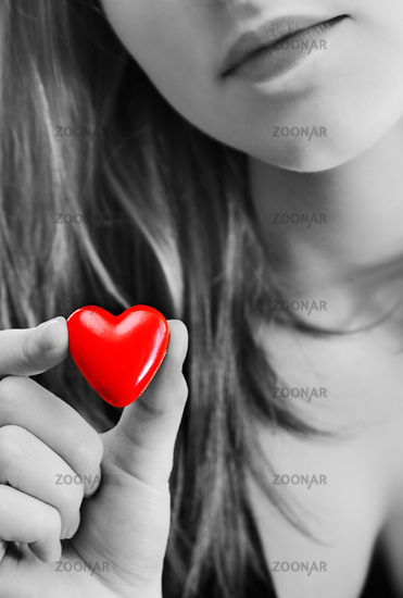Girl with toy heart
