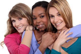 Three female friends stood in a row