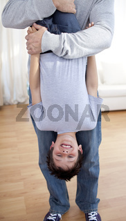 Little boy playing with his father