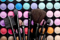 Multi colored make-up and brushes