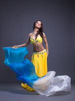 Pretty arabic dancer in yellow costume