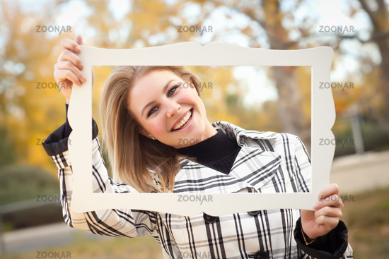 Pretty Young Woman Smiling in the Park with Picture Frame