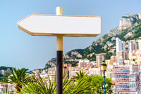 Signpost and beautiful panoramic view of Monaco on background