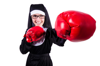 Nun with boxing gloves isolated on white