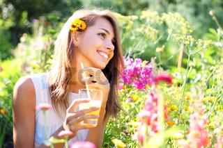 Joyful girl keeps juice