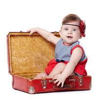 beautiful baby with suitcase