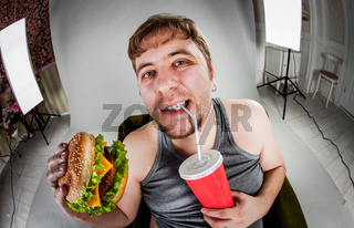 fat man eating hamburger