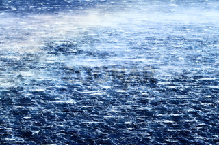 Raging sea with furious waves and fierce wind