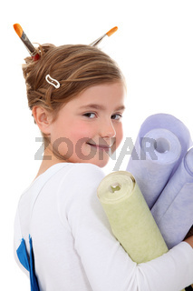little girl dressed as a painter holding wallpapers