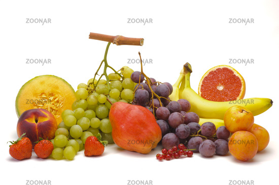 mixed fresh fruits over white background